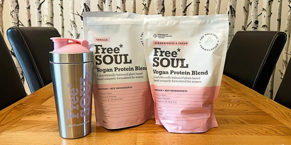 Two packets of Free Soul Vegan Protein Blend and a shaker
